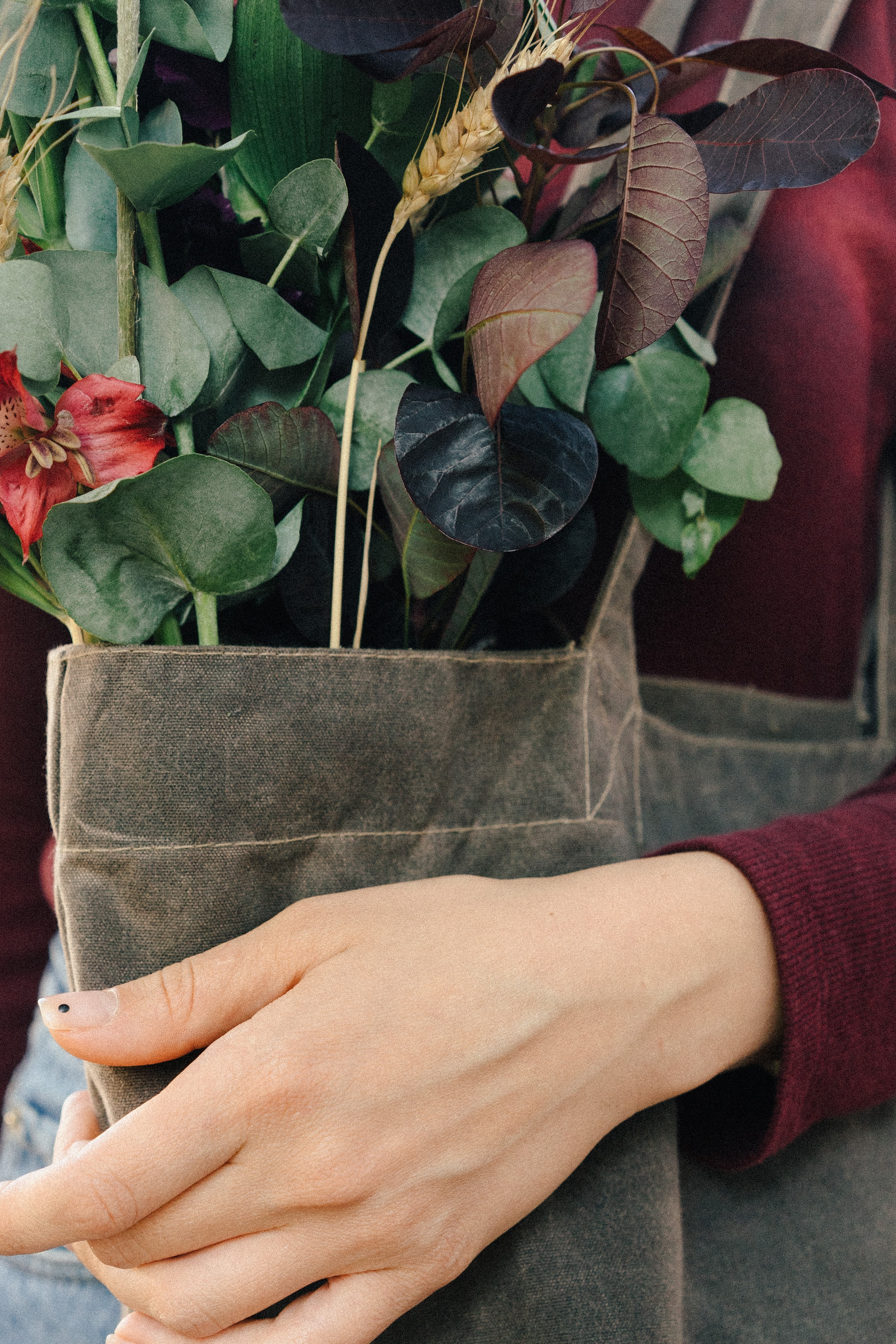 woman carrying brown tote bag with flower