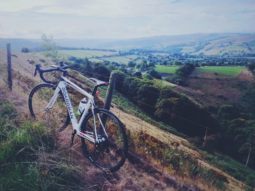 white Boardman road bike park on hill