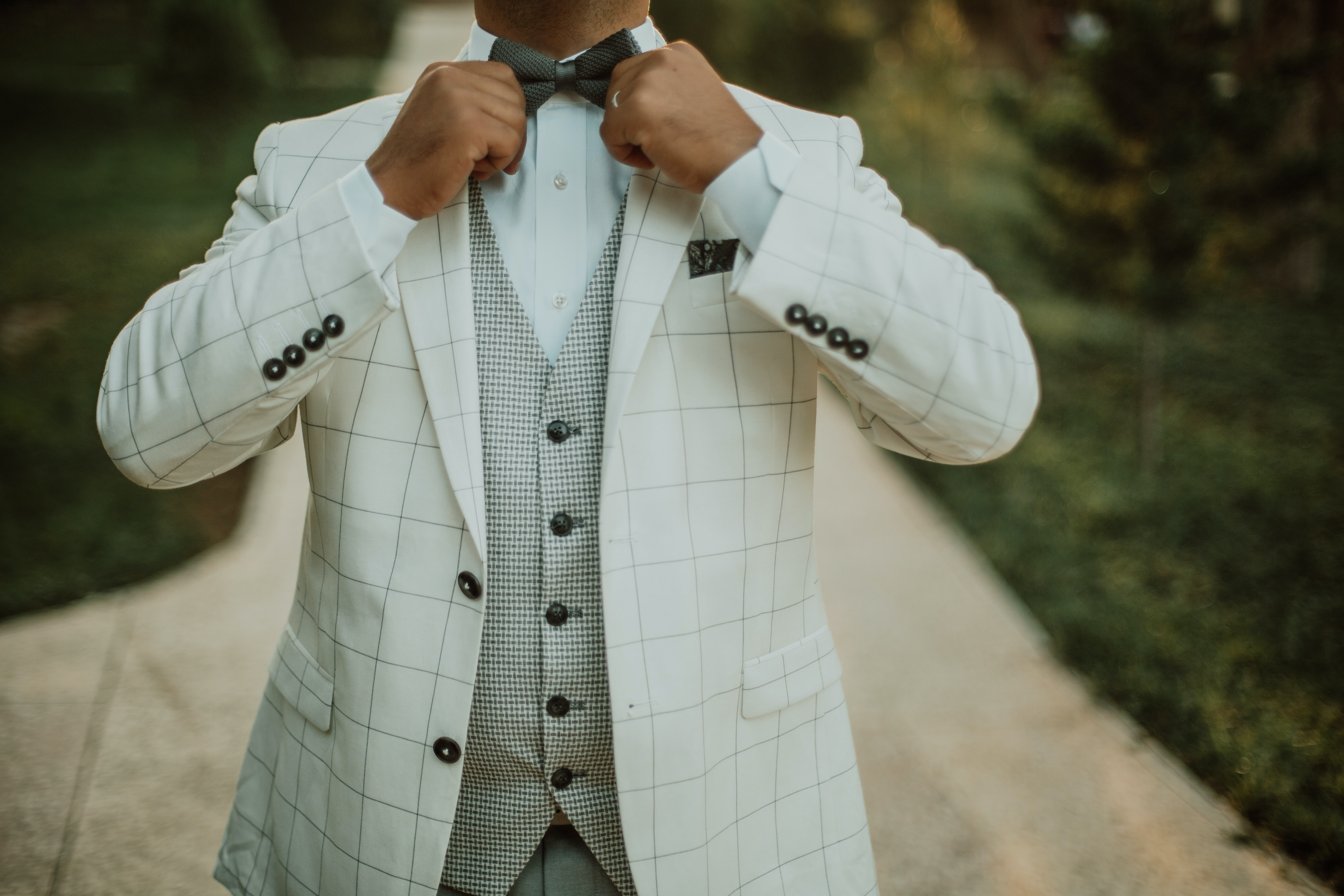 man in white suit jacket