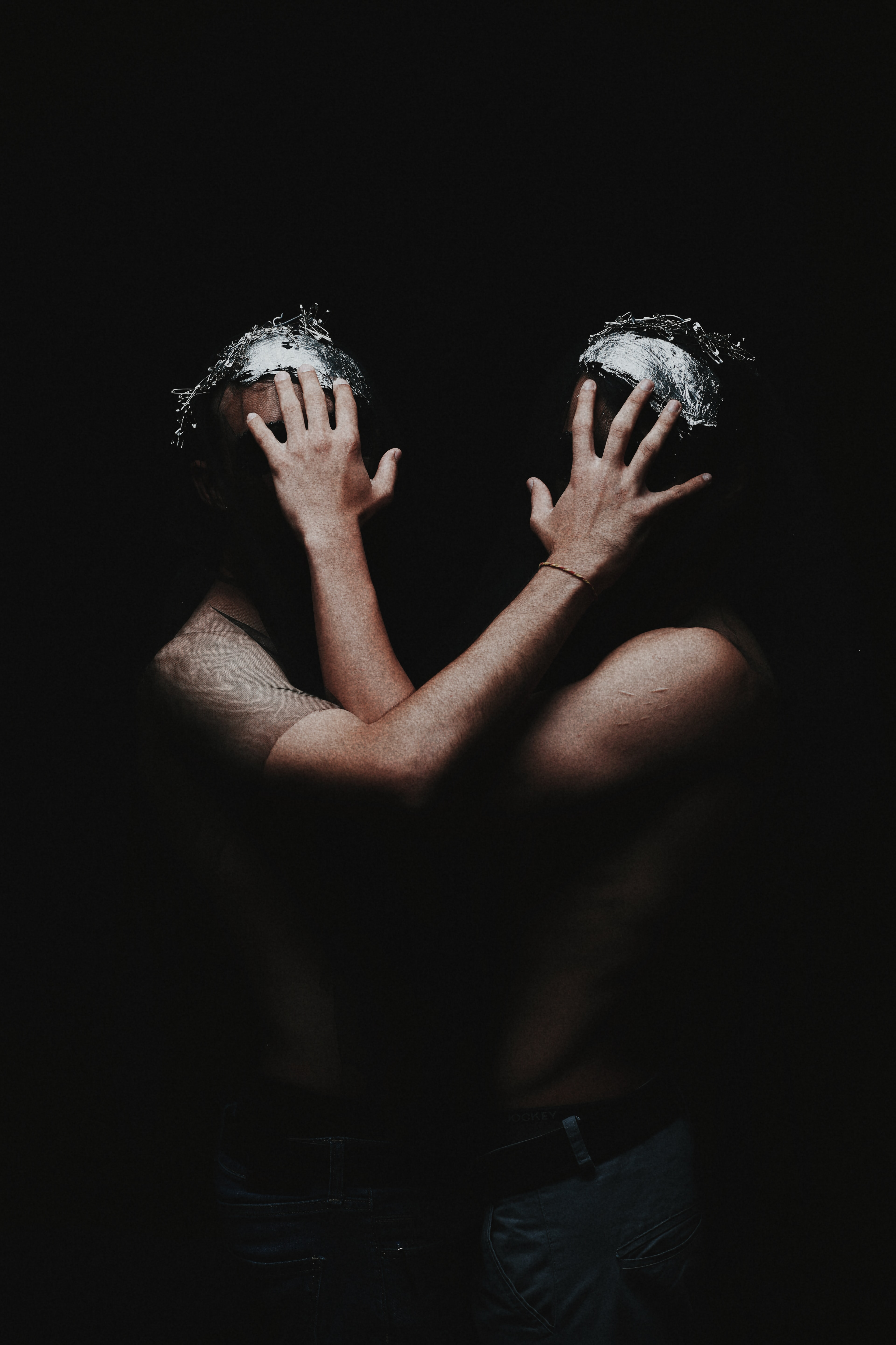 two human hand covering both human faces art