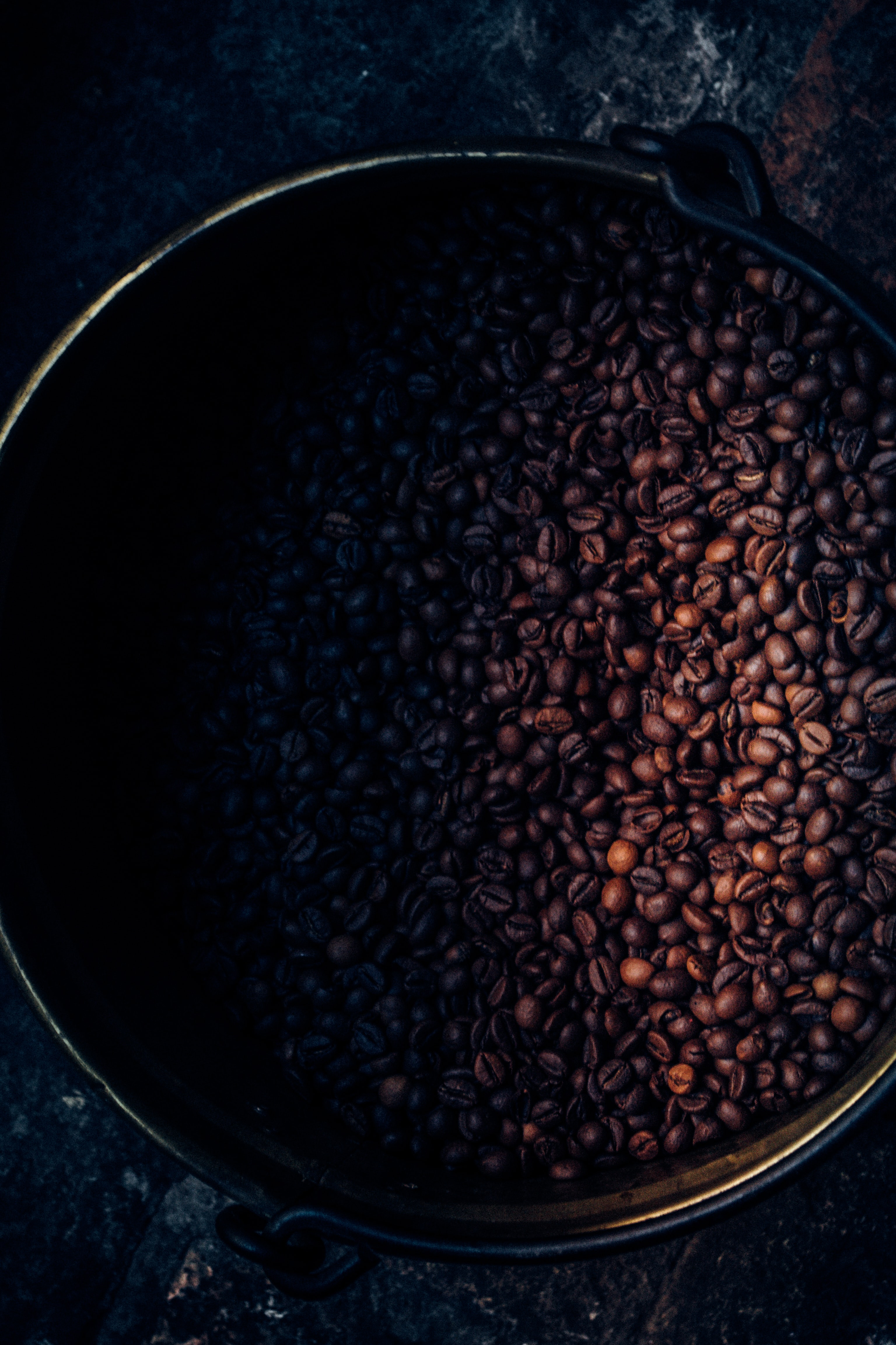 black and brown coffee beans on container