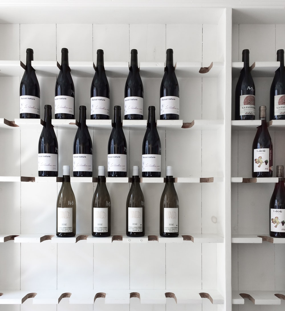 wine bottle on white wooden shelf