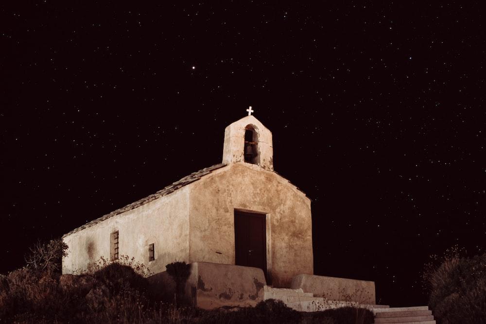 beige concrete church during nighttime