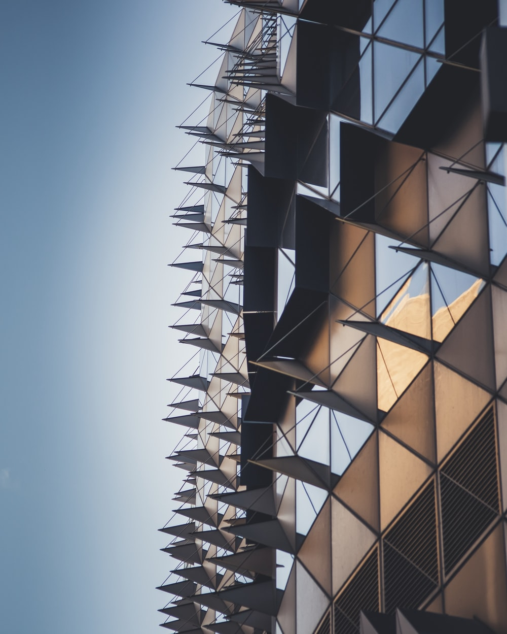low-angle photography of brown and clear building during daytime