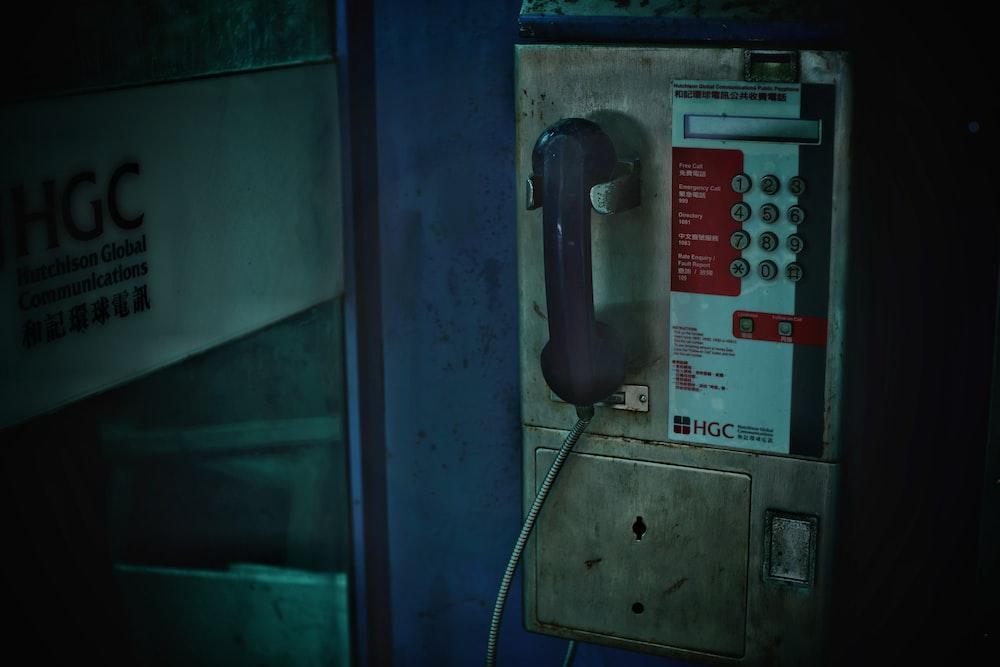 gray hanging telephone