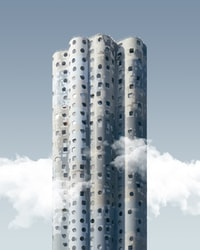 gray building with clouds