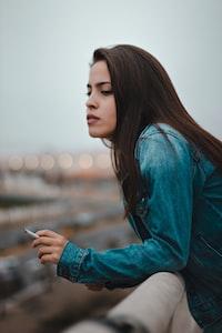 woman holding cigarette