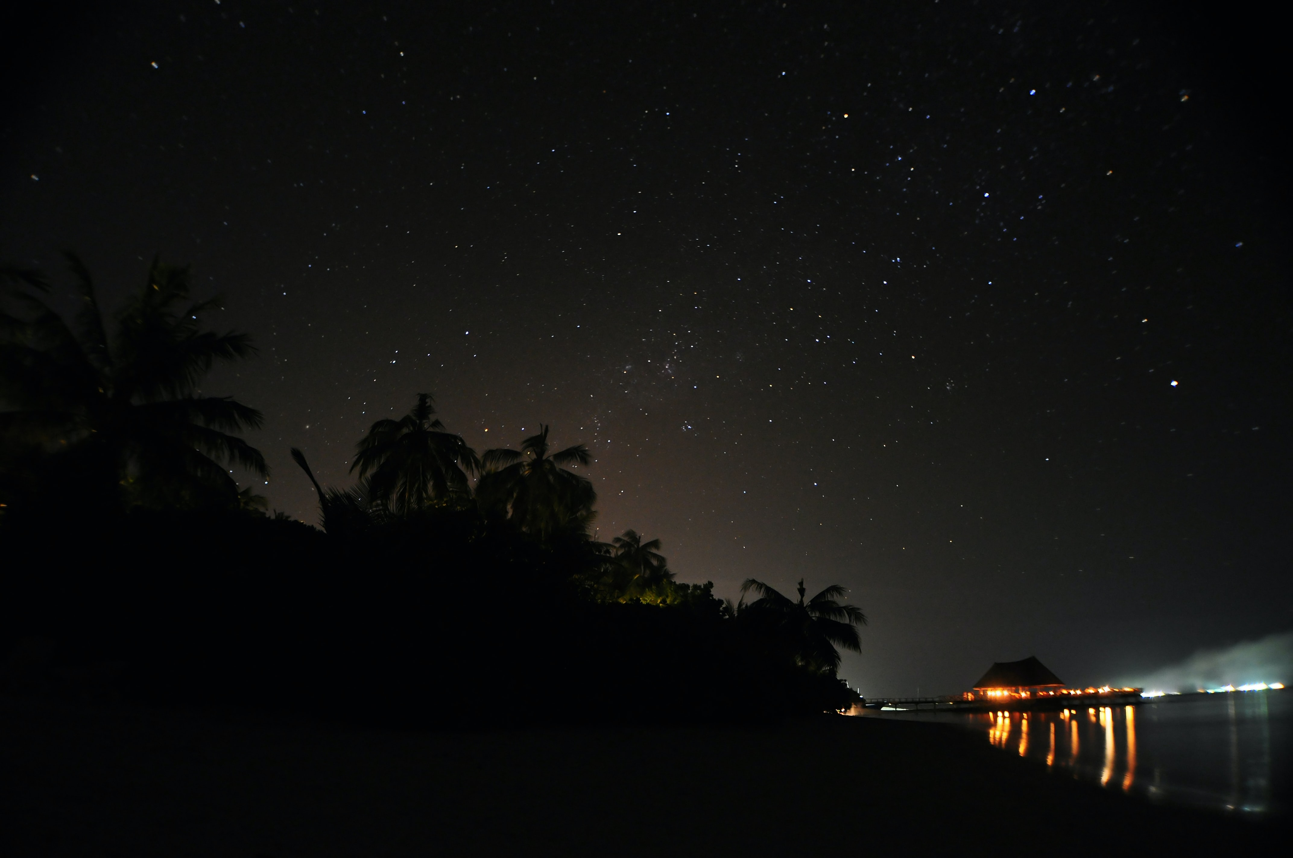 lighted house in island during nighttime