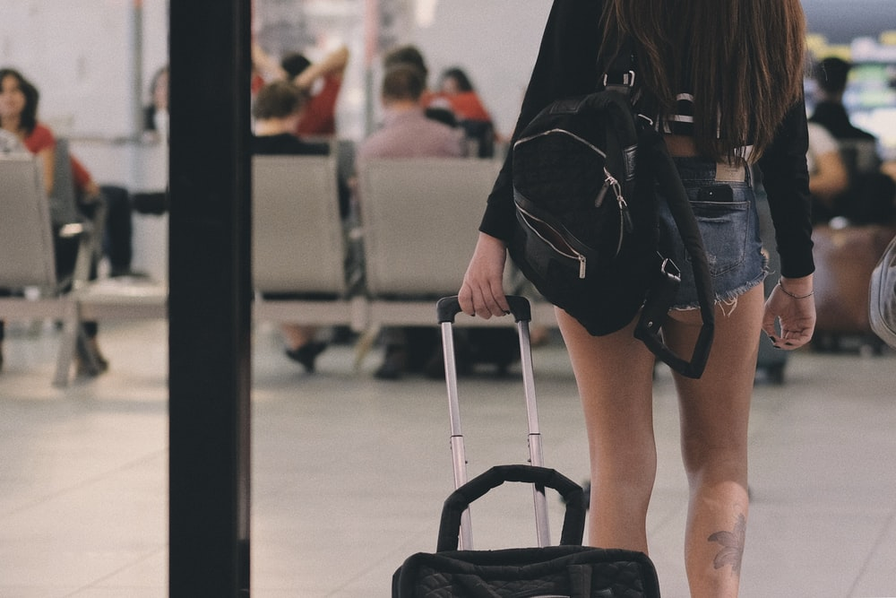 woman holding luggage