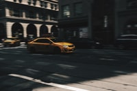 selective focus photo of beige metallic sedan