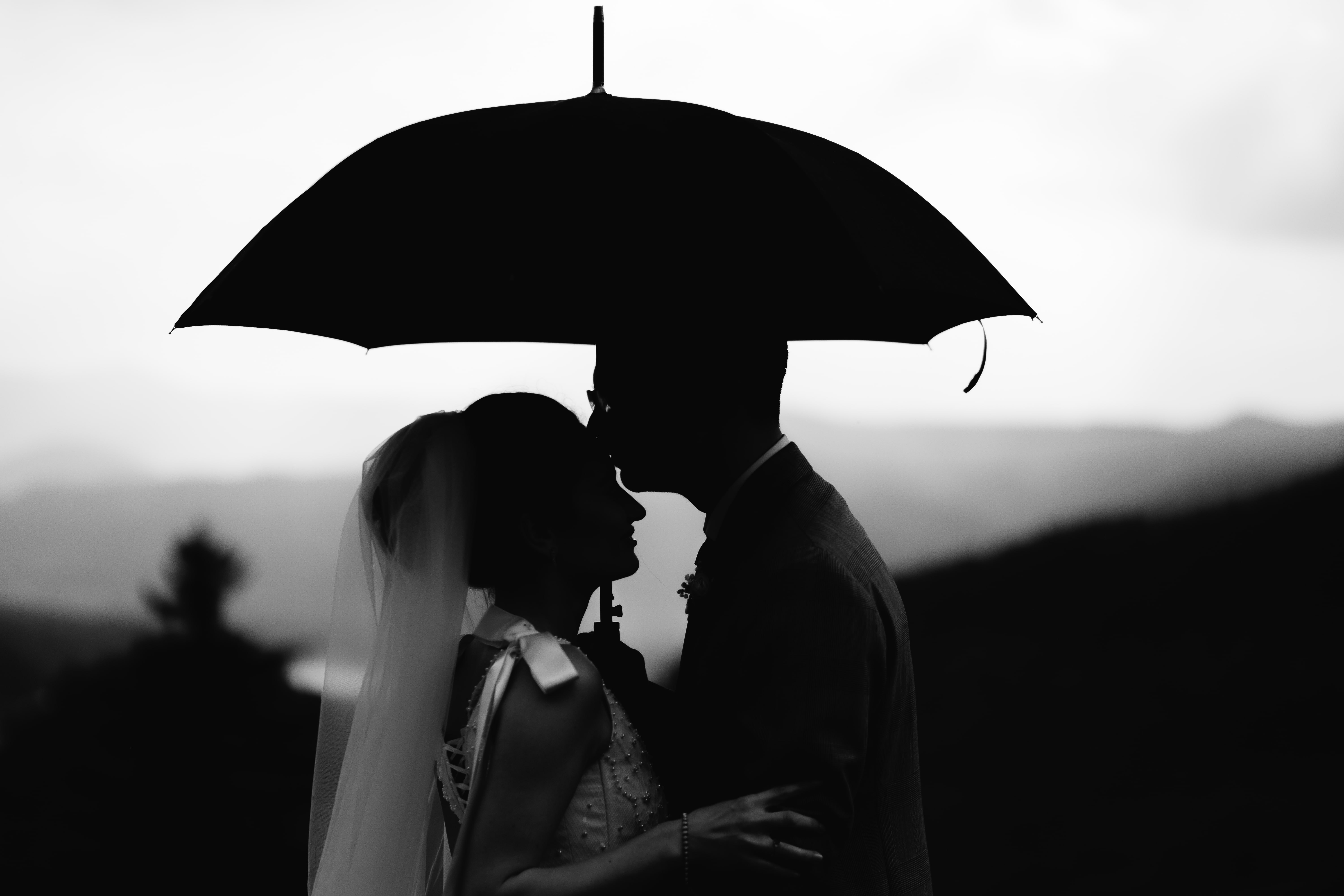 grayscale photography of bride and groom