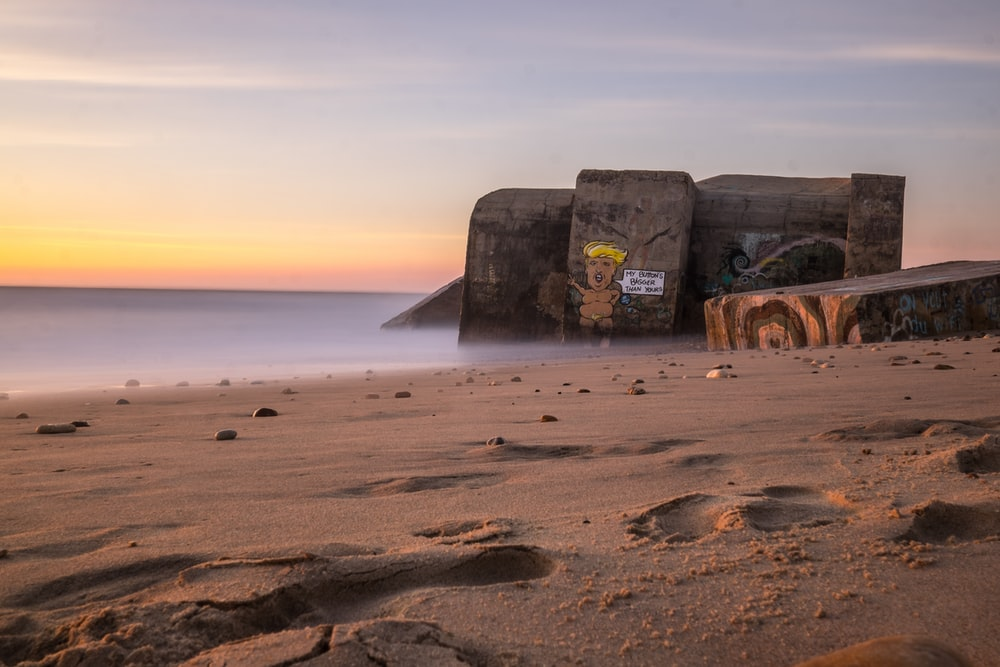 landscape photography of concrete building by the sea