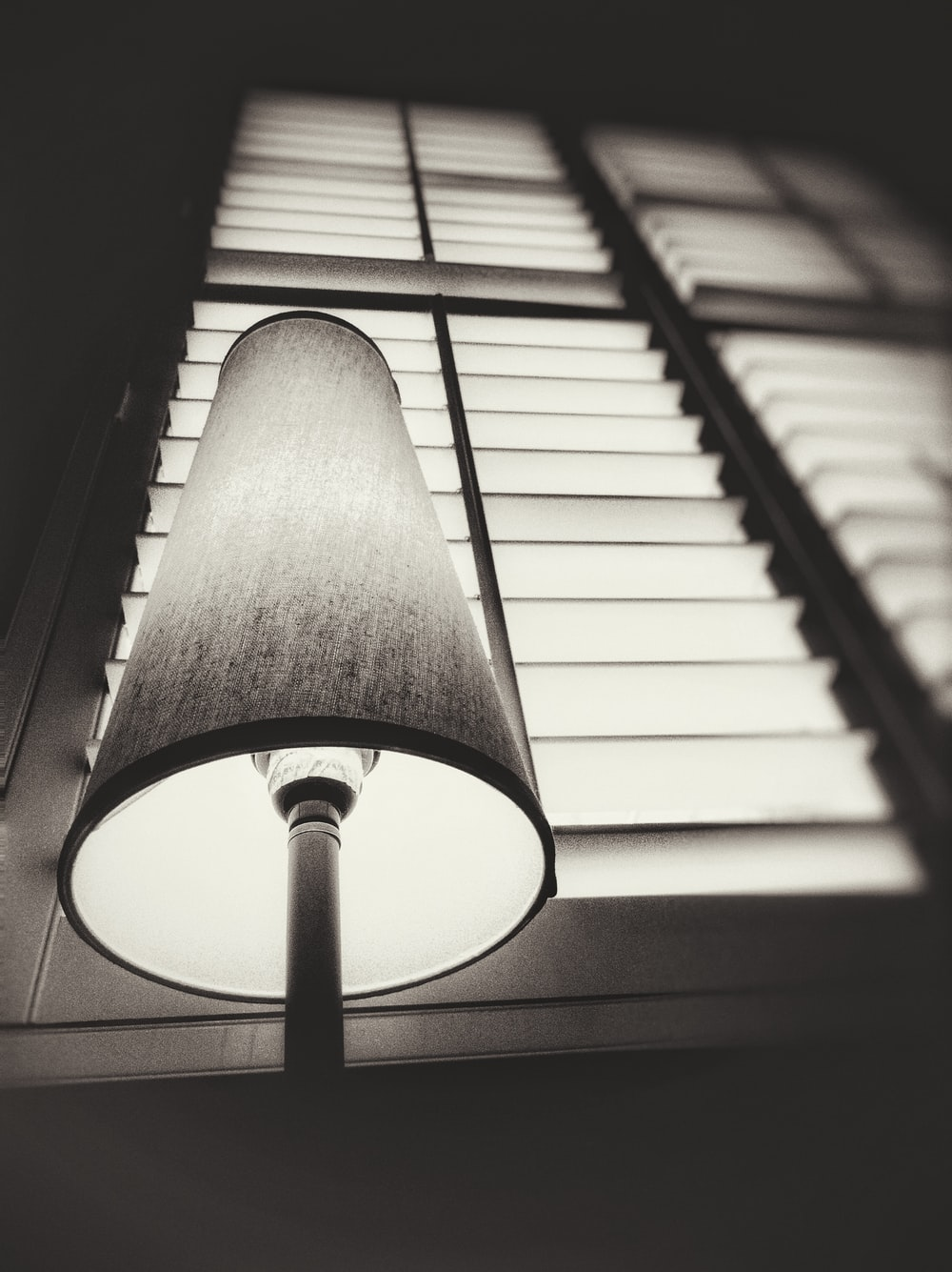 grayscale photography of table lamp