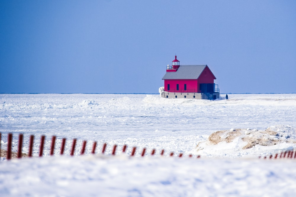 red house on snow field