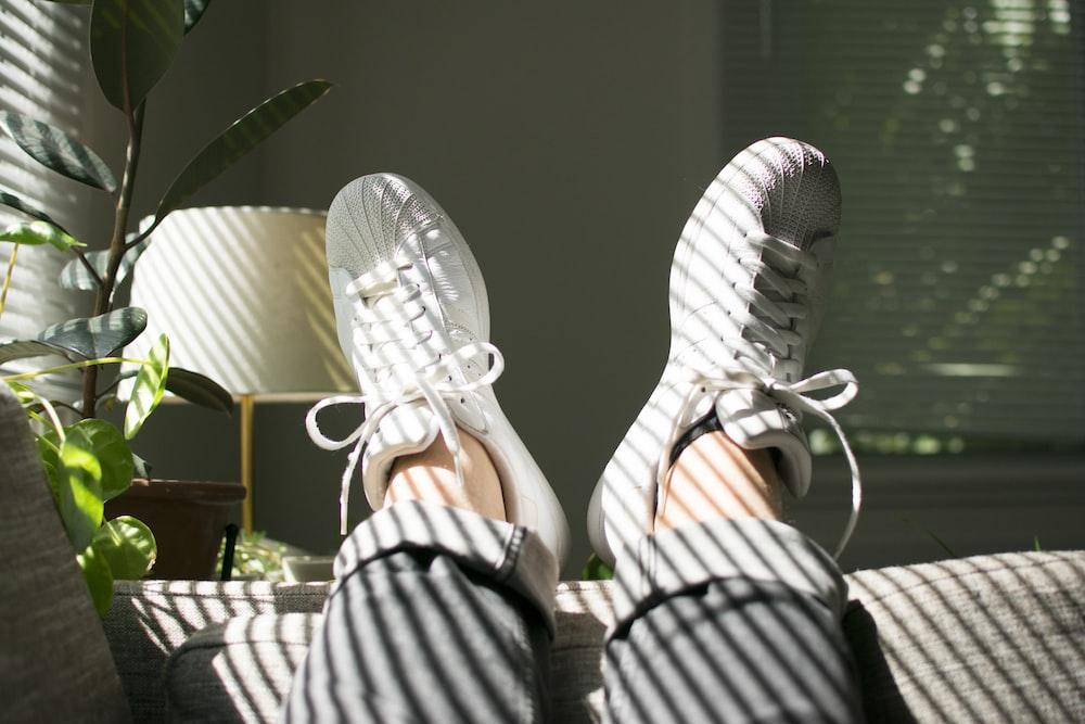 pair of white adidas superstar sneakers