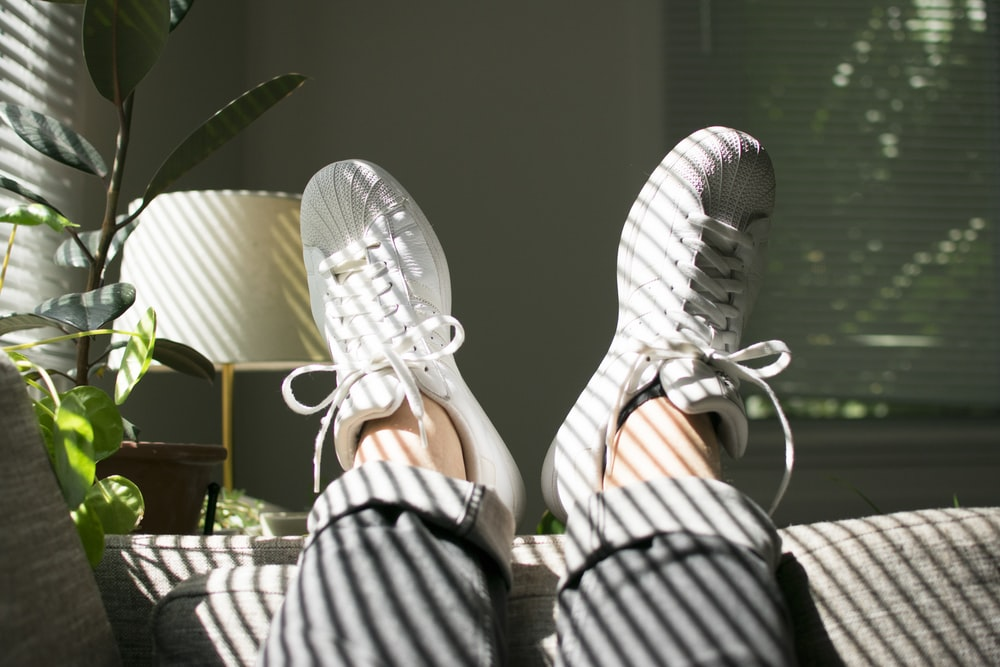 pair of white adidas superstar sneakers