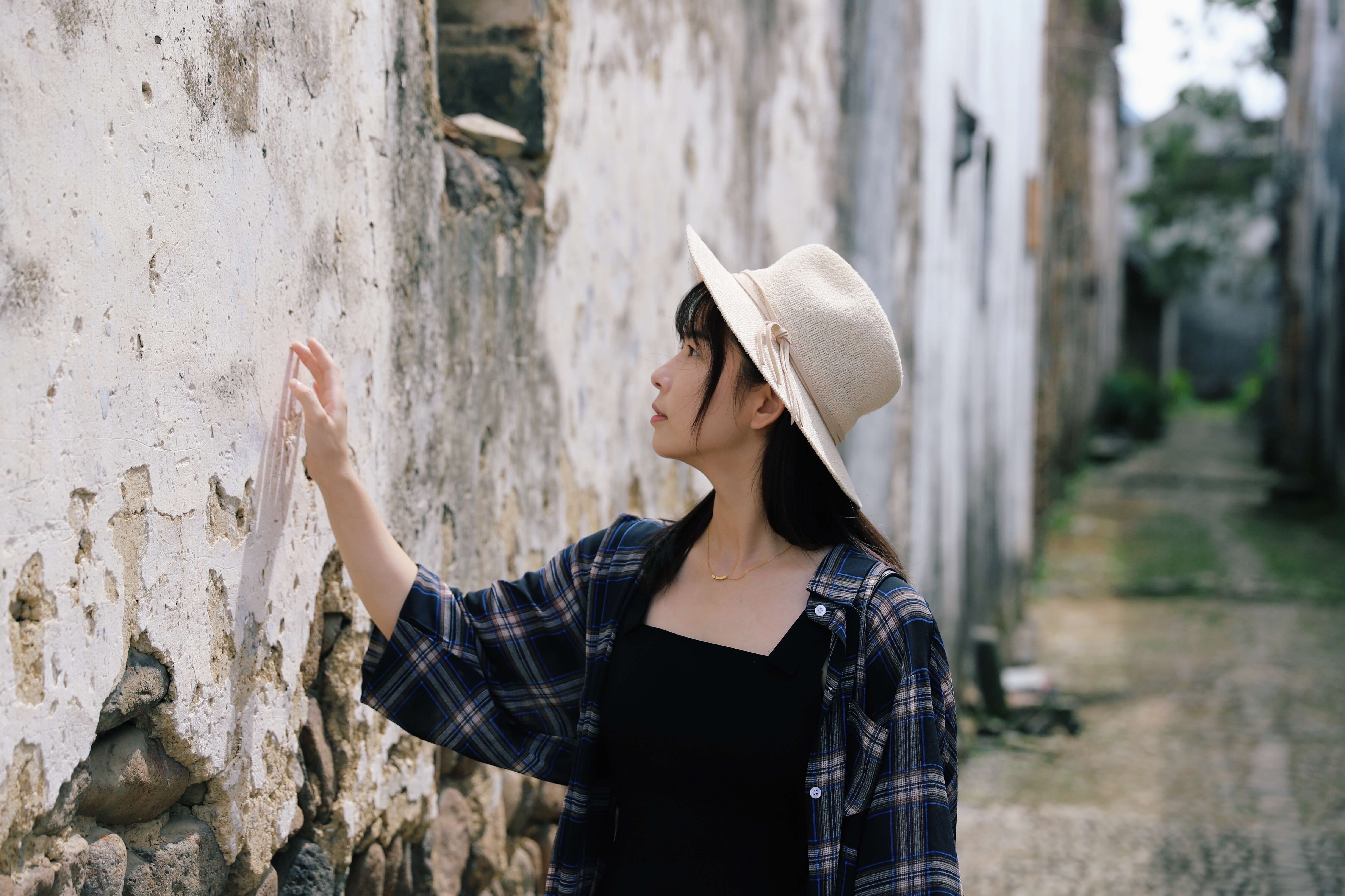 selective focus photography of woman touching wall