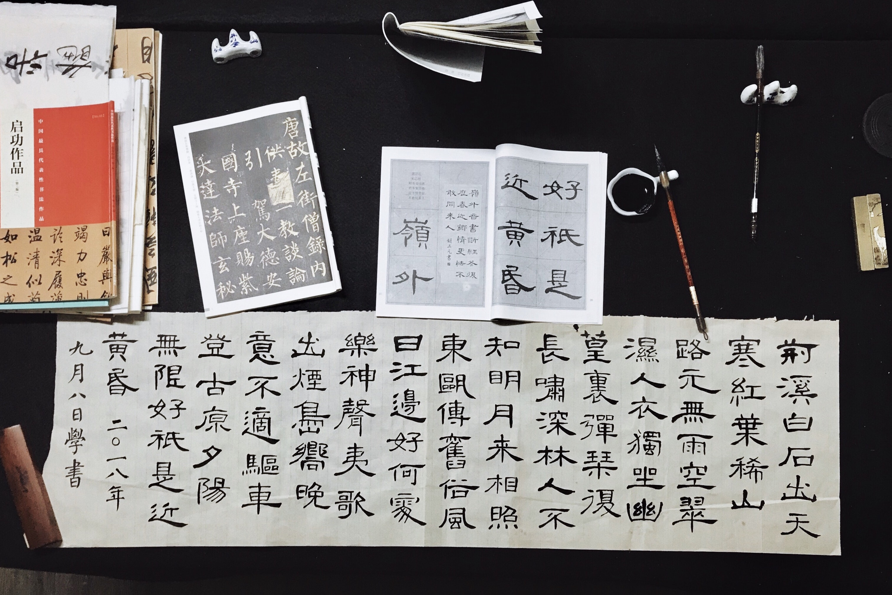 black and white kanji calligraphy poster on top of black table