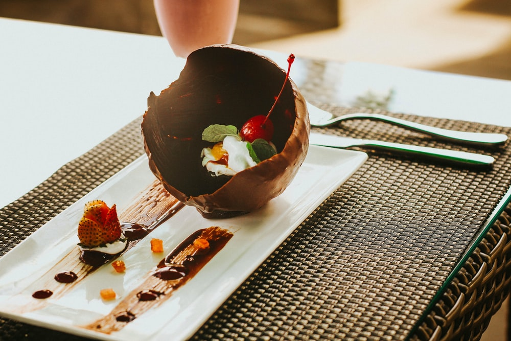 melted chocolate ball with fruits