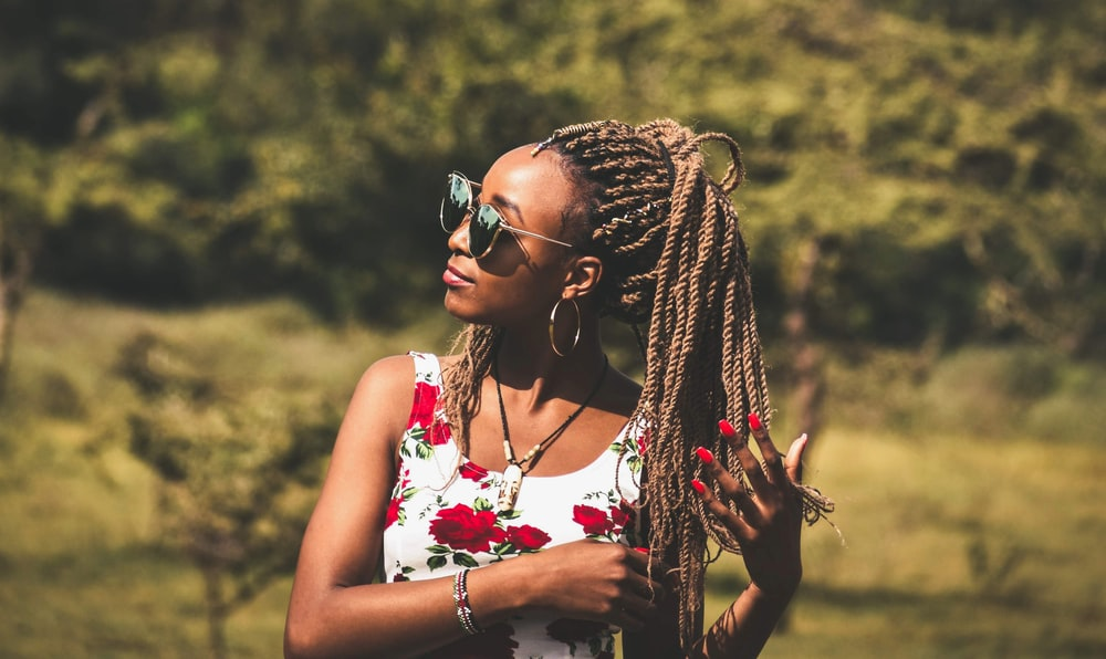woman holding her braided hair