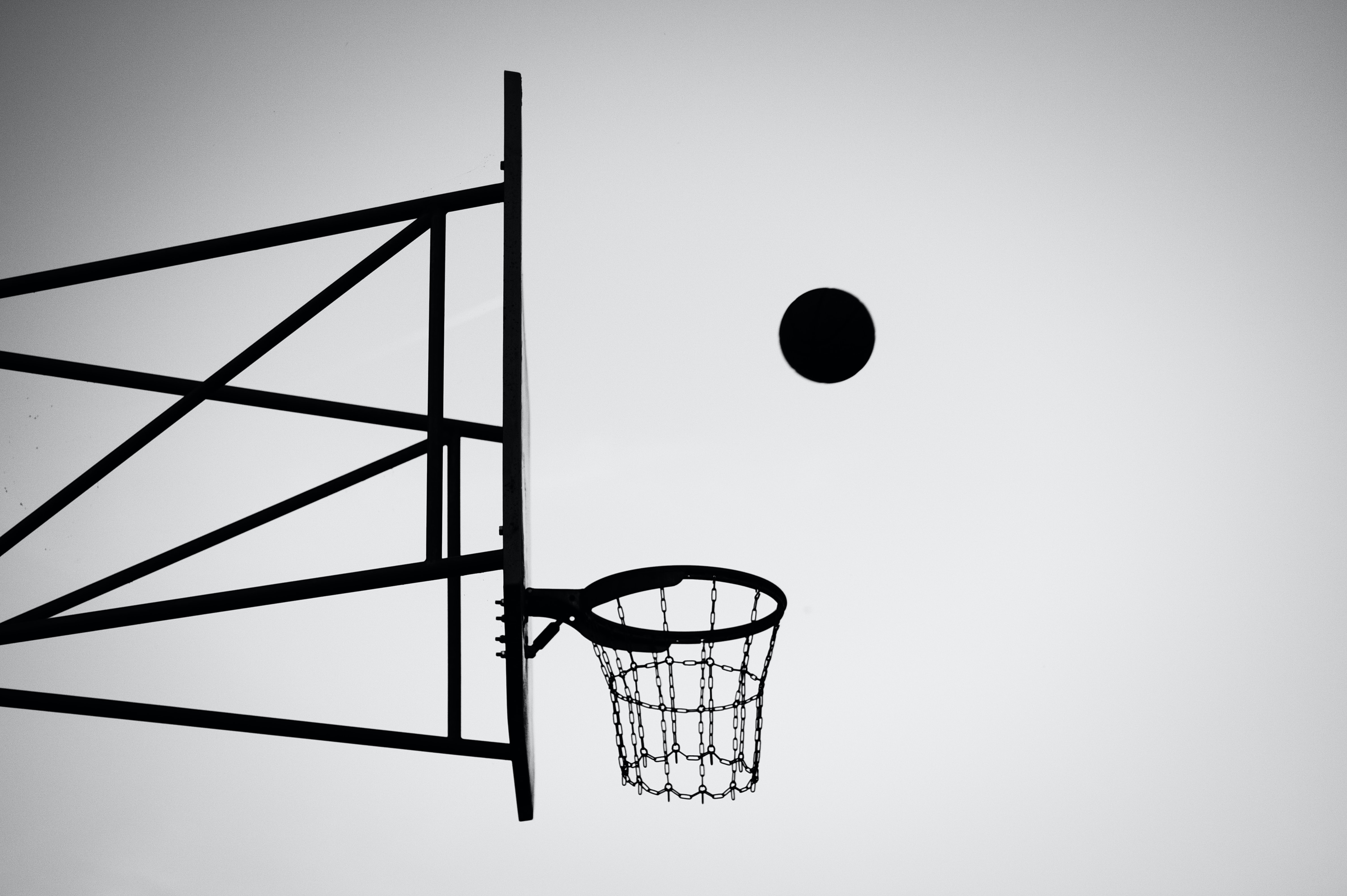 grayscale photo of ball about to shoot