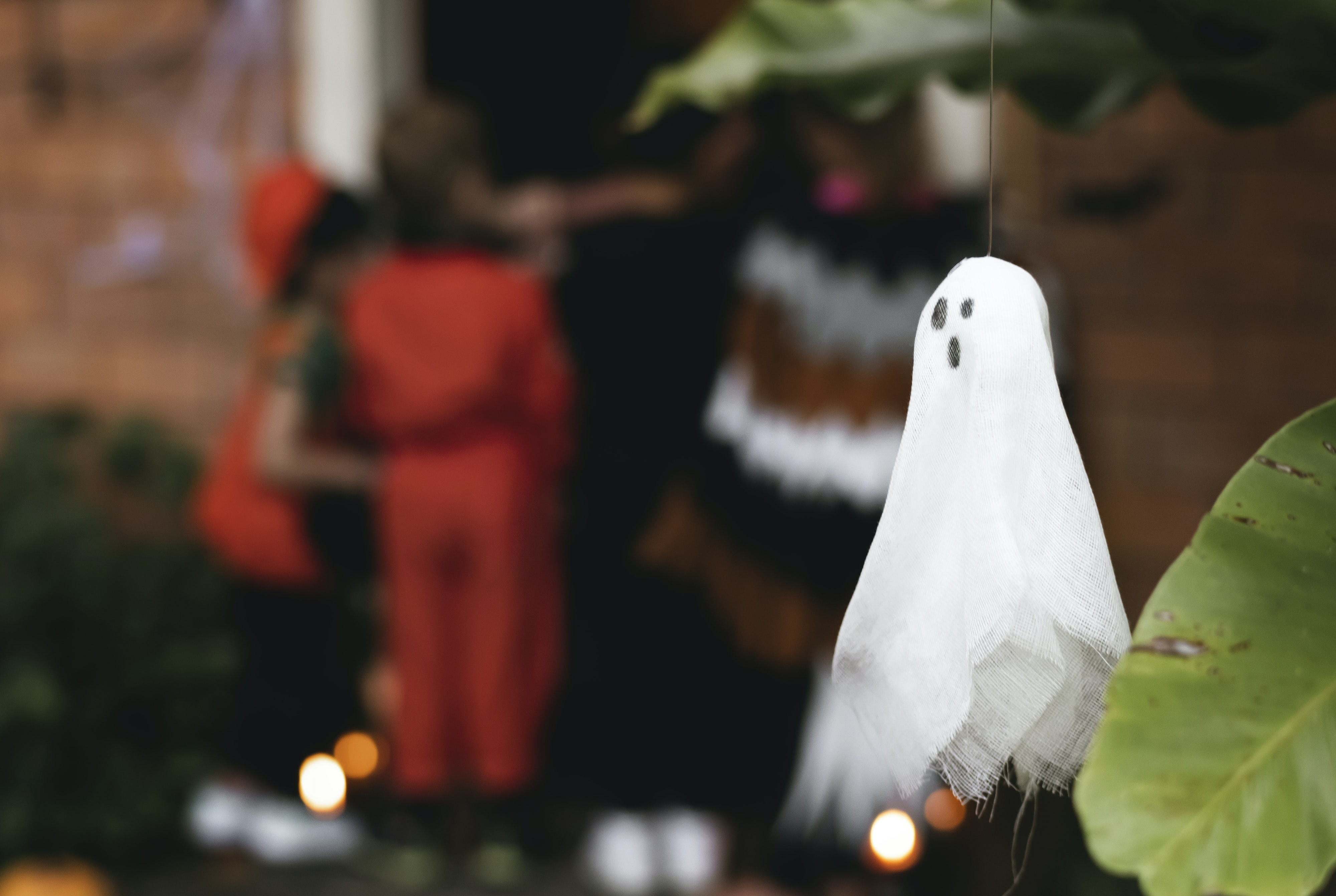 selective focus photo of hanging white ghost decor