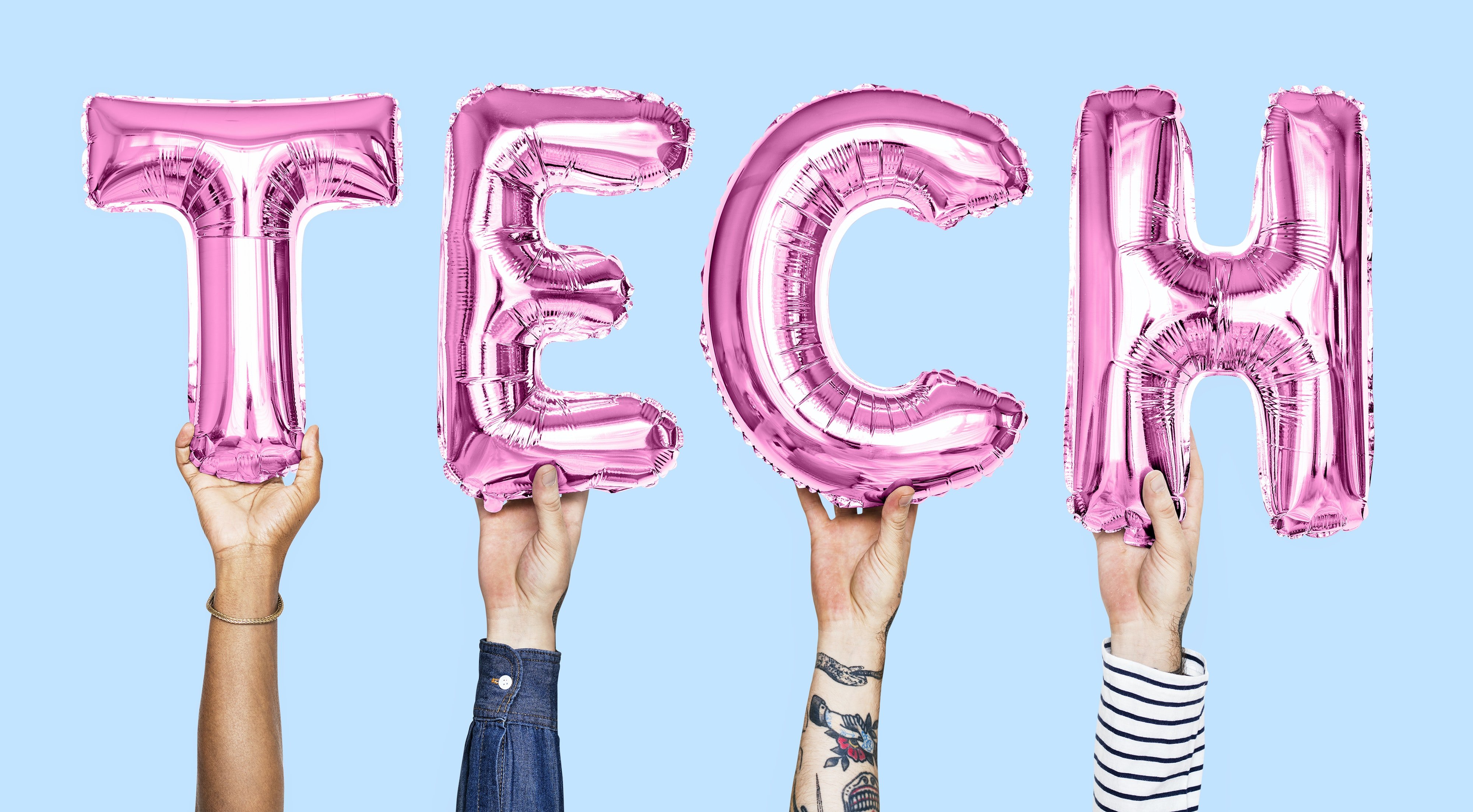 four person holding pink TECH balloons