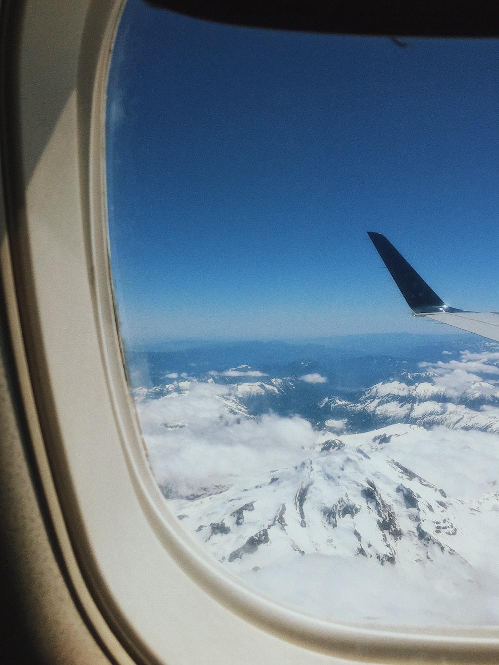 white airplane window at daytime
