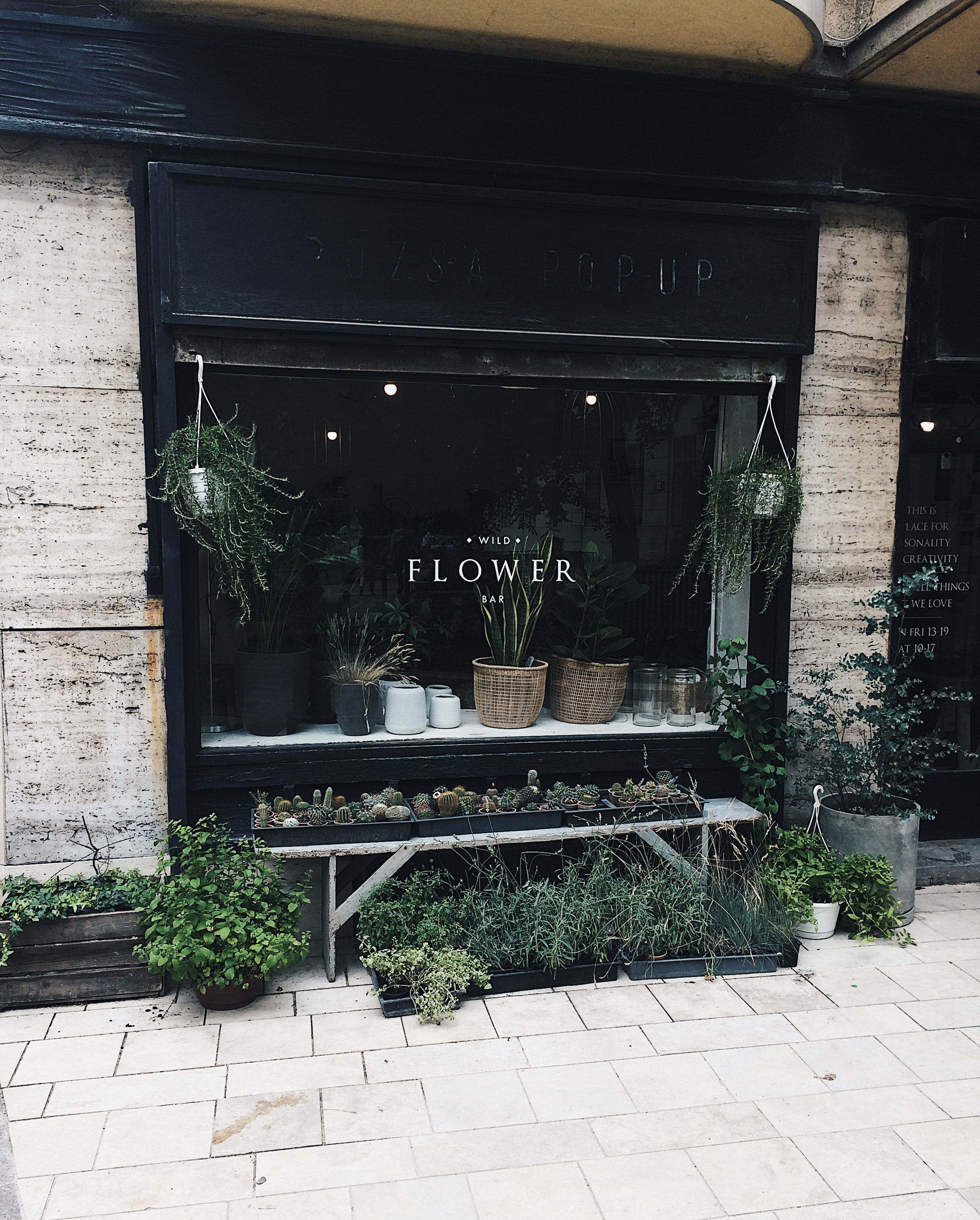 black wooden flower shop front
