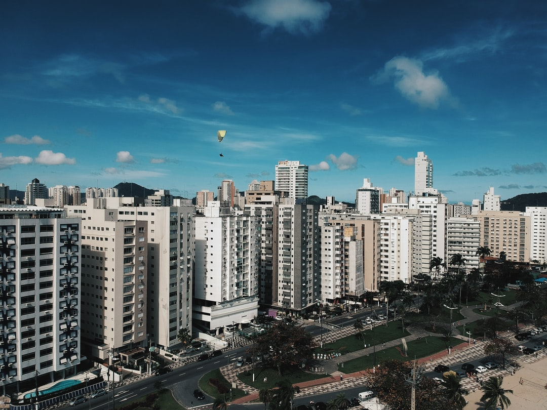 """During a drone flight saw this """"skywalker"""" flying in my neighborhood. The Foo Fighter's song """"The Sky is a Neighborhood"""" came to my mind right on time and I shot this picture of a flying man into a concrete jungle."""