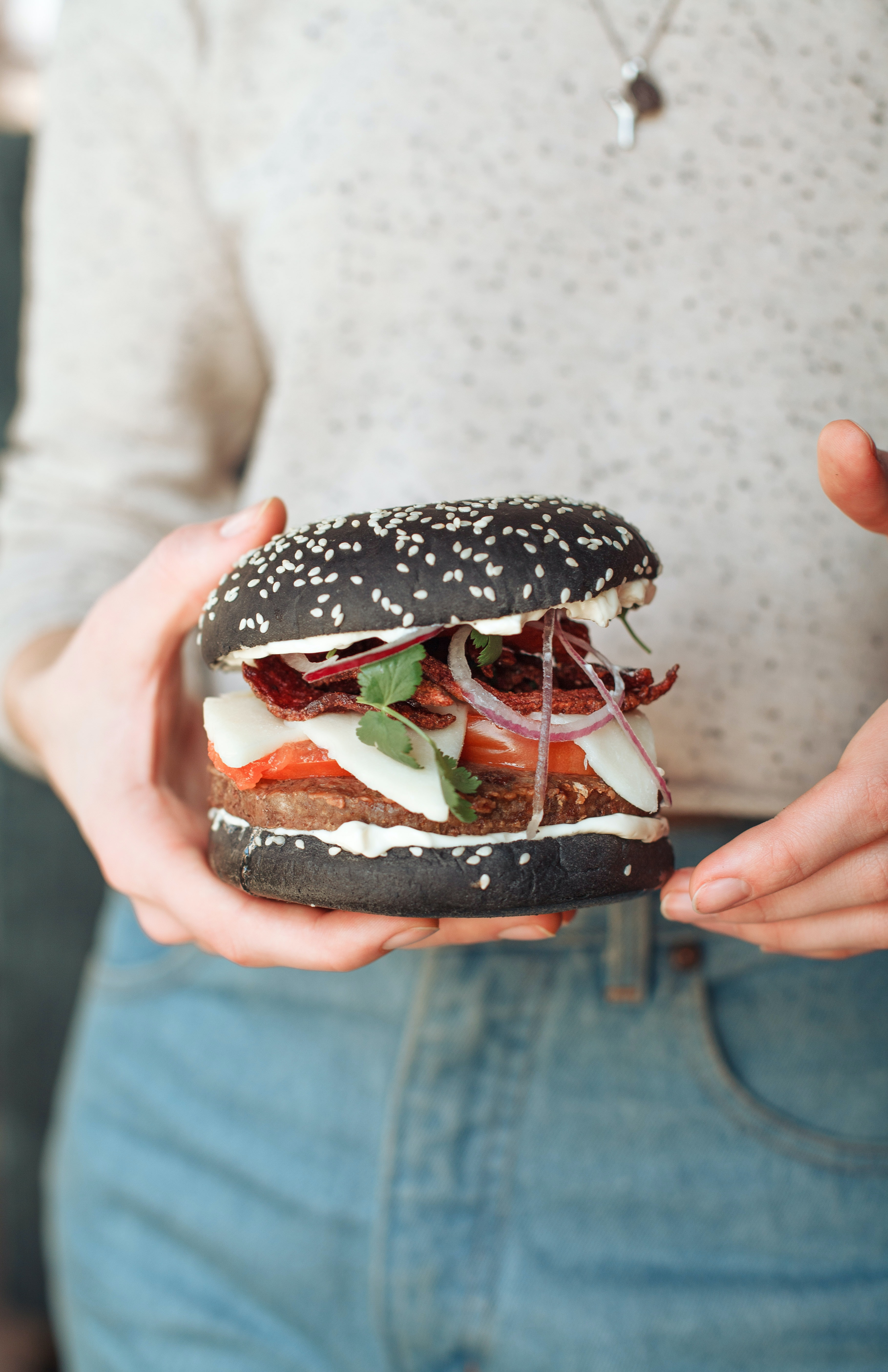 person holding burger