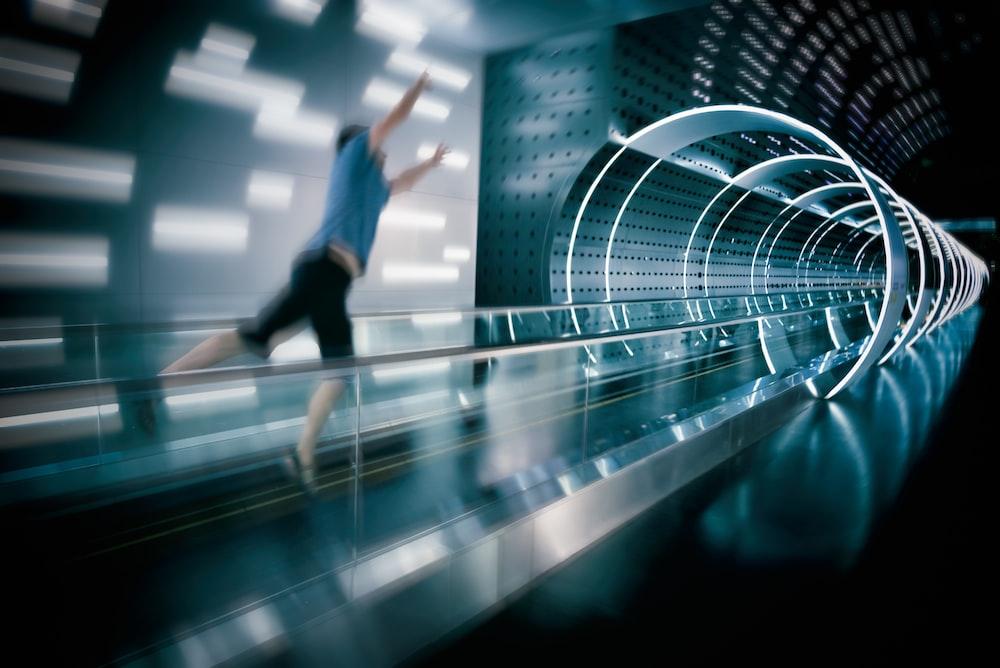 man jumps on escalator