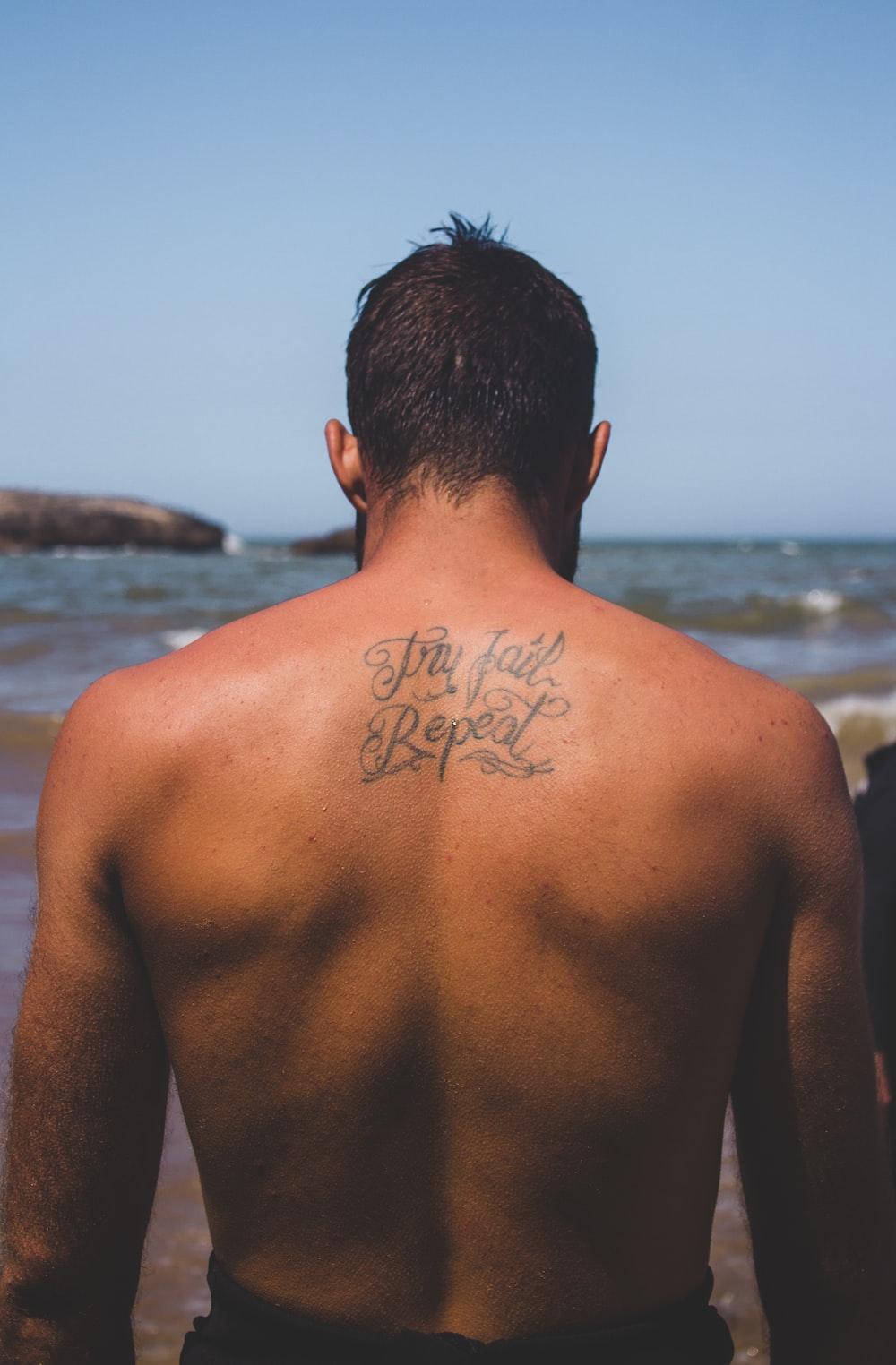 black calligraphy tattoo