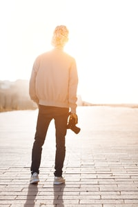 person standing while holding camera