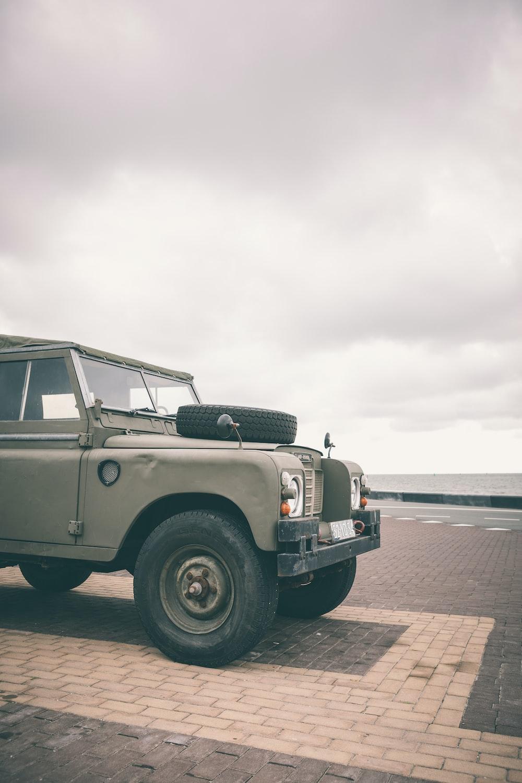 gray vehicle under gray sky at daytime