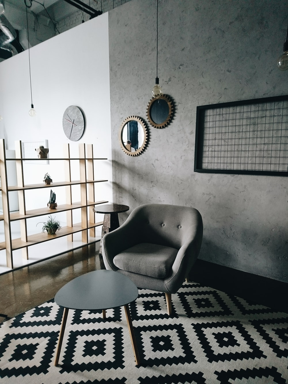 gray padded couch in front of wooden center table