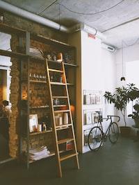 brown wooden ladder beside rack