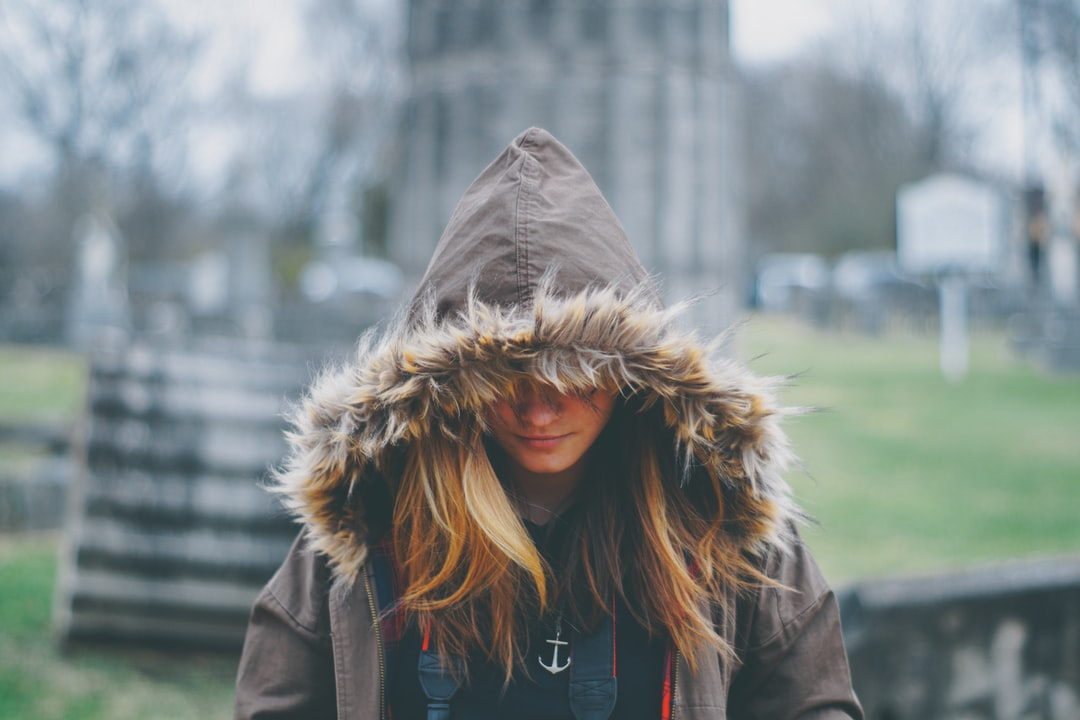As we were shaking in our boots due to the terribly cold temperature, the wind hit just right as we were walking through an old civil war cemetery in historic Downtown Franklin. I was jealous that she had the comfortable warm fuzzy hood… I was under dressed when I took this!