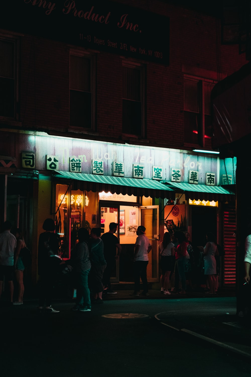 people standing in front of store during nighttime