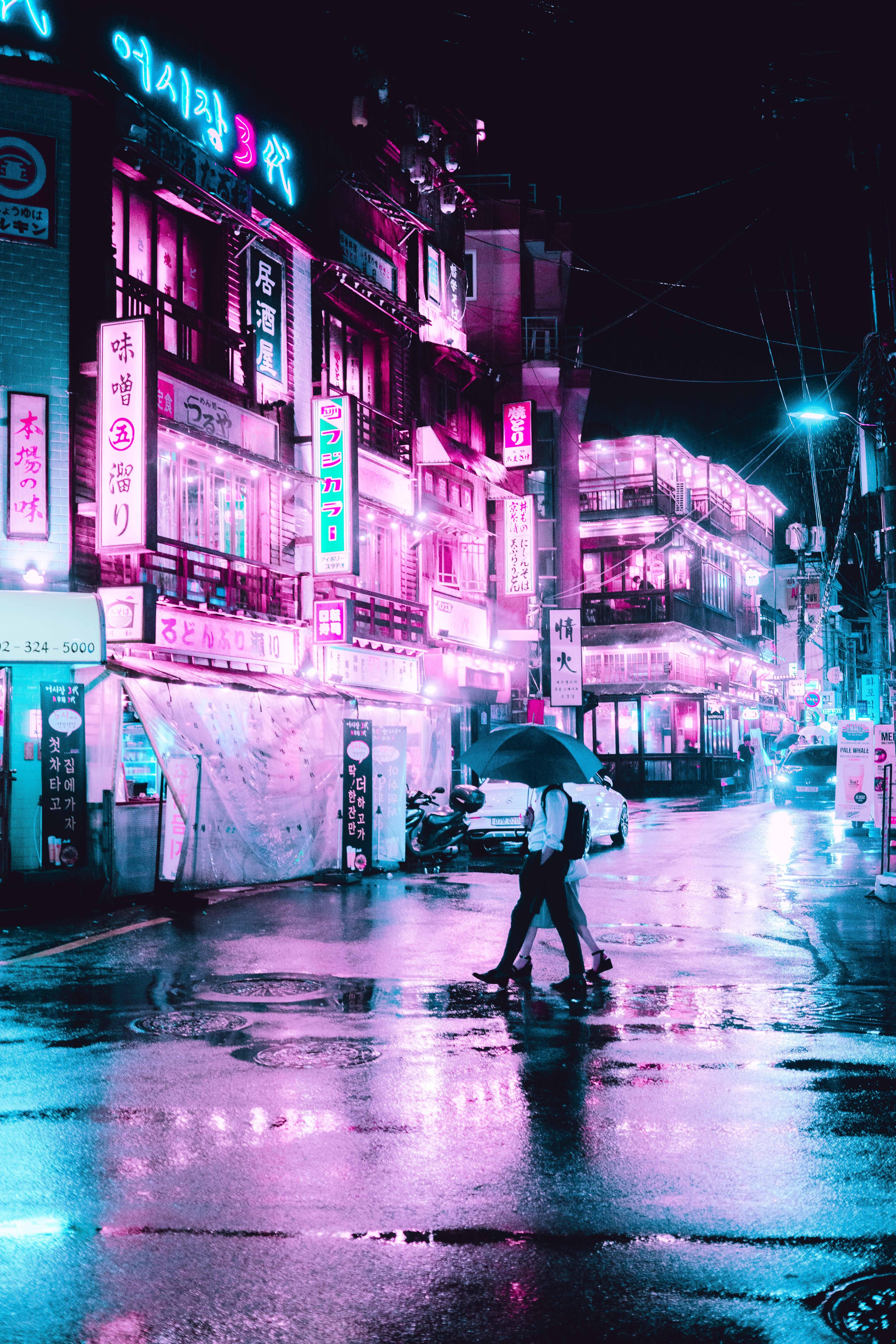 man under gray umbrella