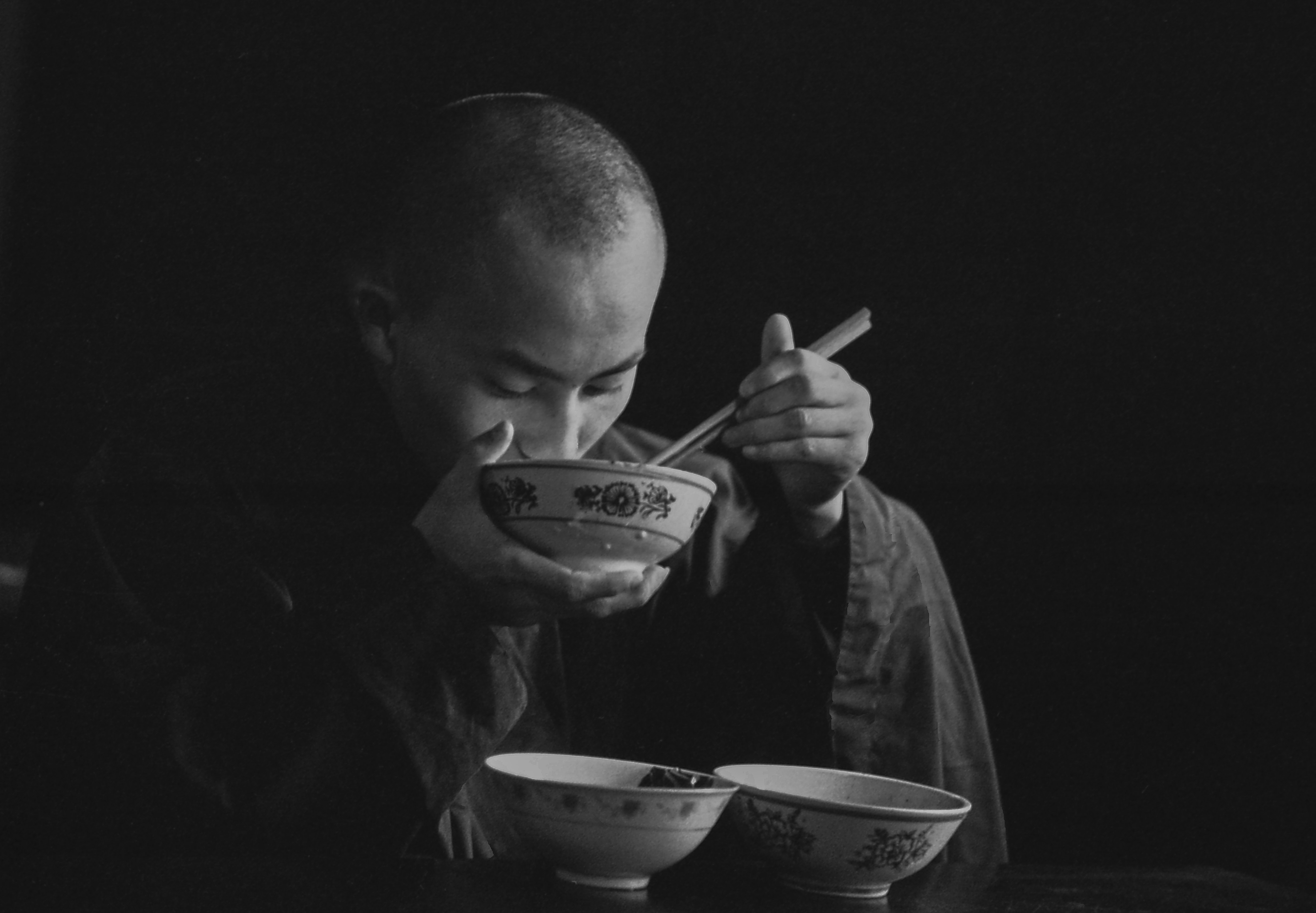 grayscale photography of eating macn