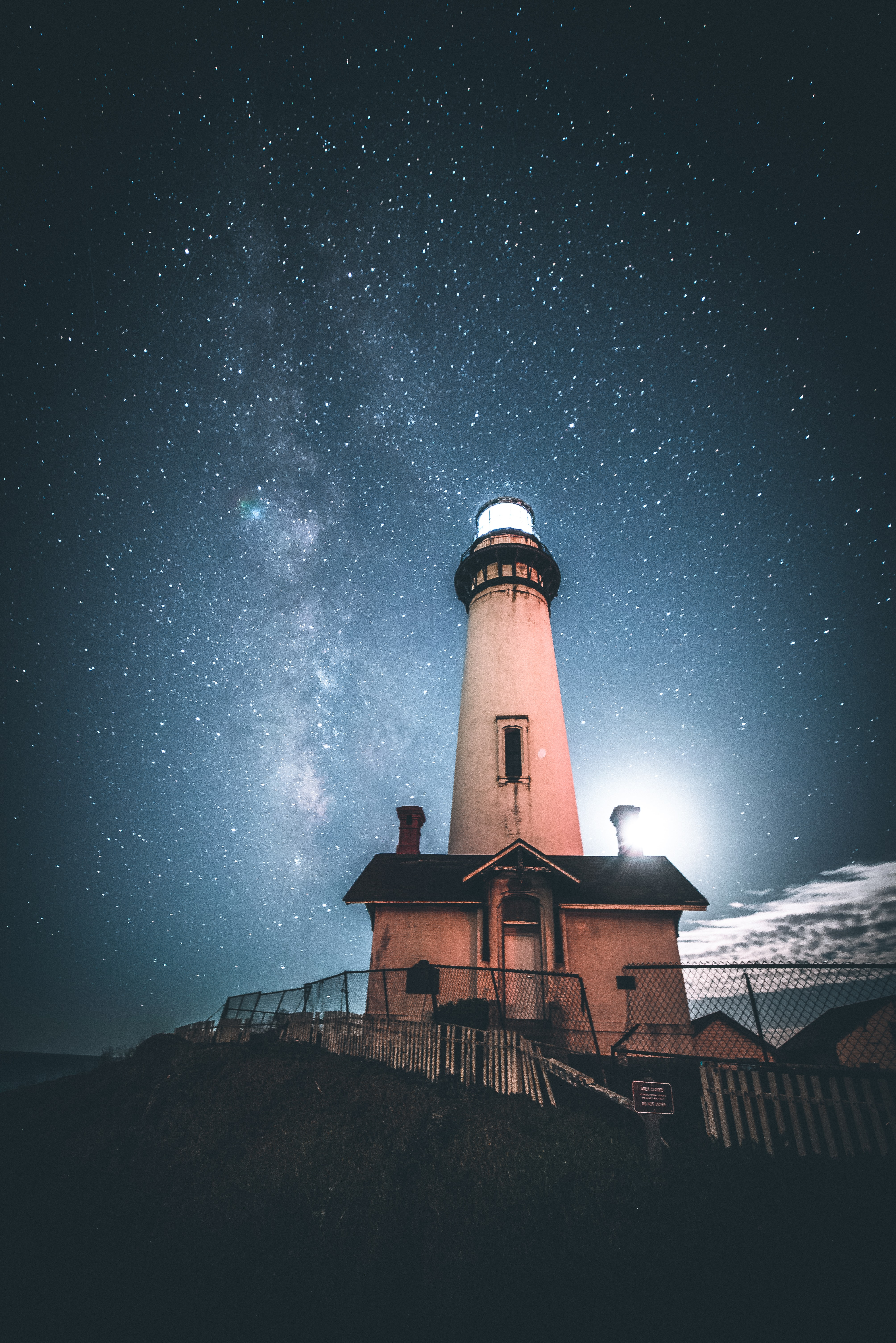 white and black lighthouse during nighttime