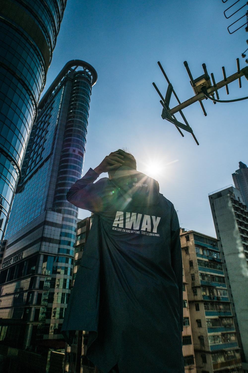 man facing building