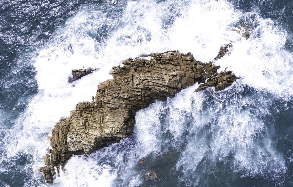 waves crashing on rock formation