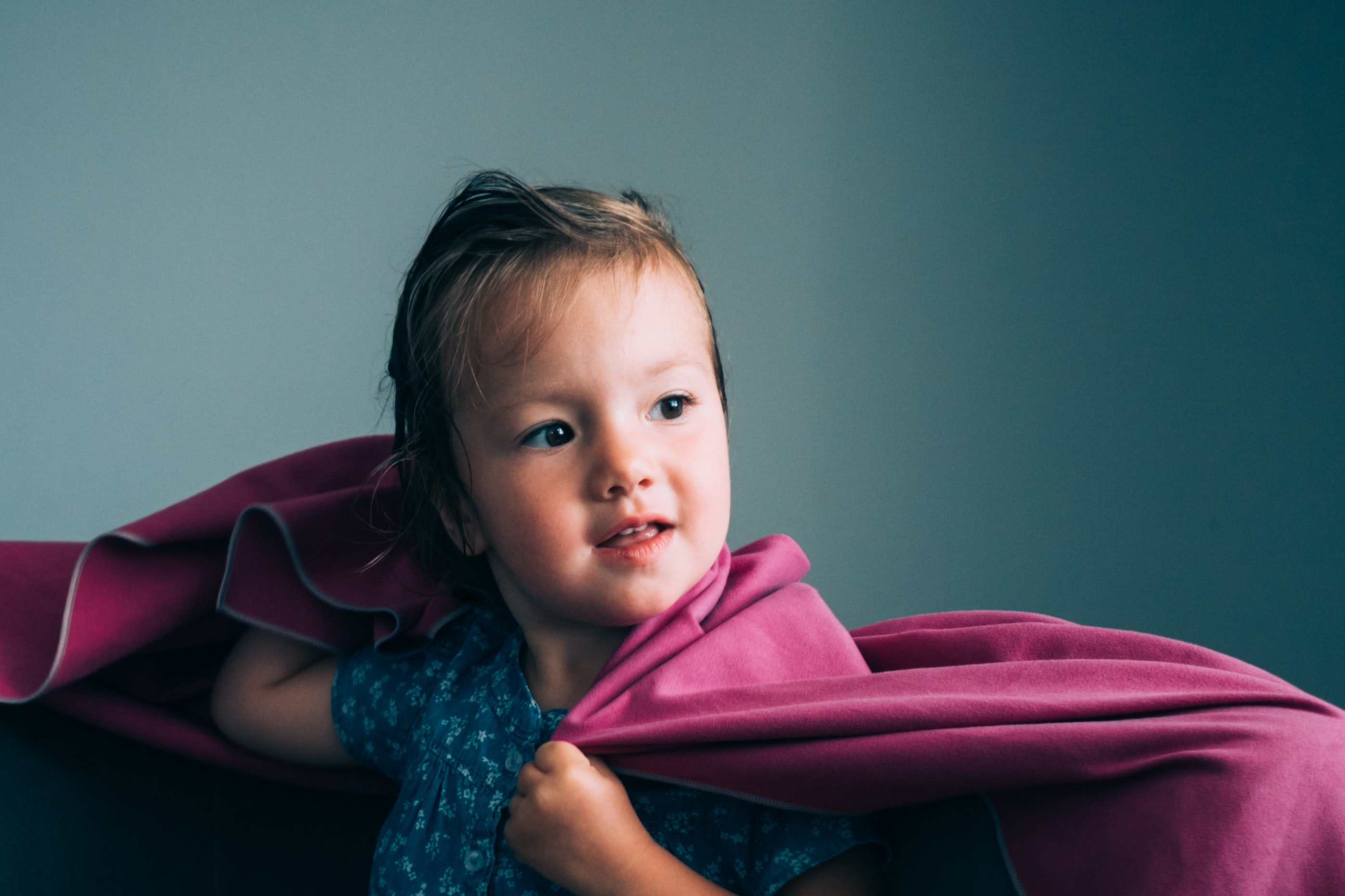 toddler covered in pink textile