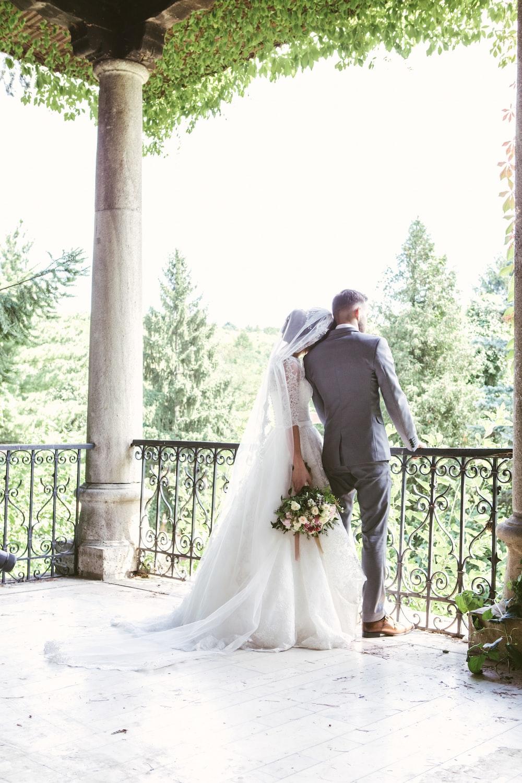 man and woman standing near railings