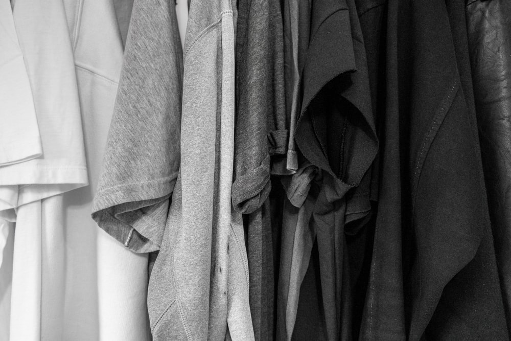 grayscale photography of assorted clothes