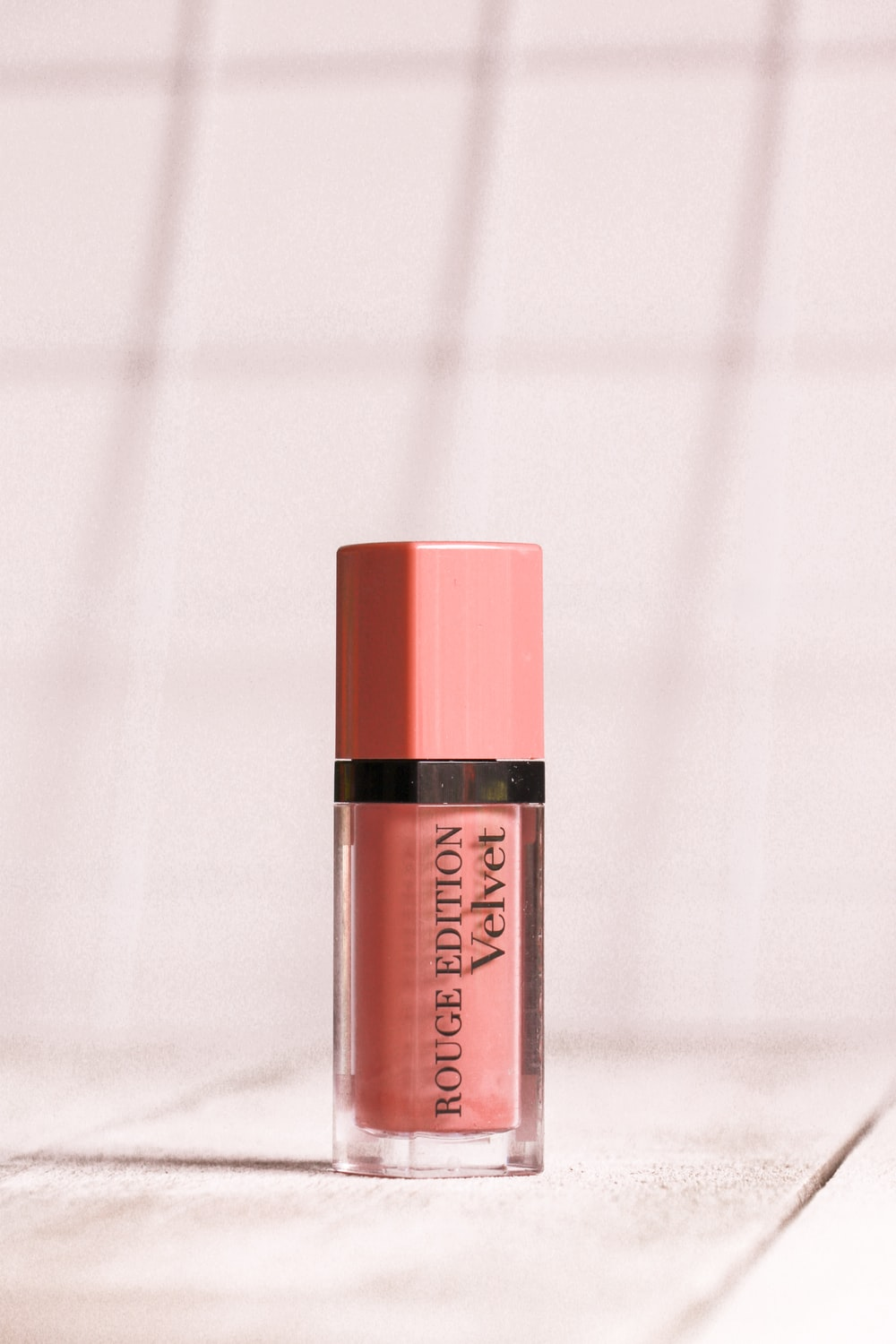 pink Rouge Edition lipstick on white surface