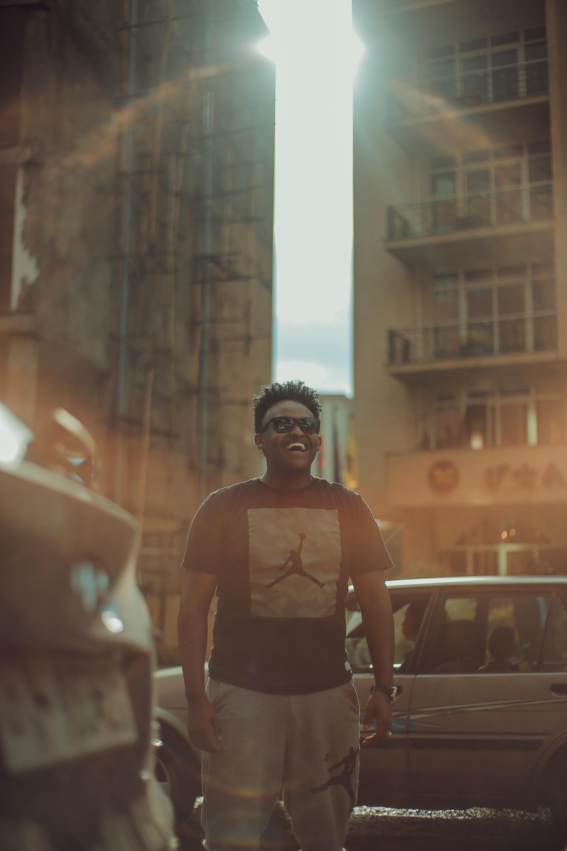 man in black Air Jordan shirt laughing