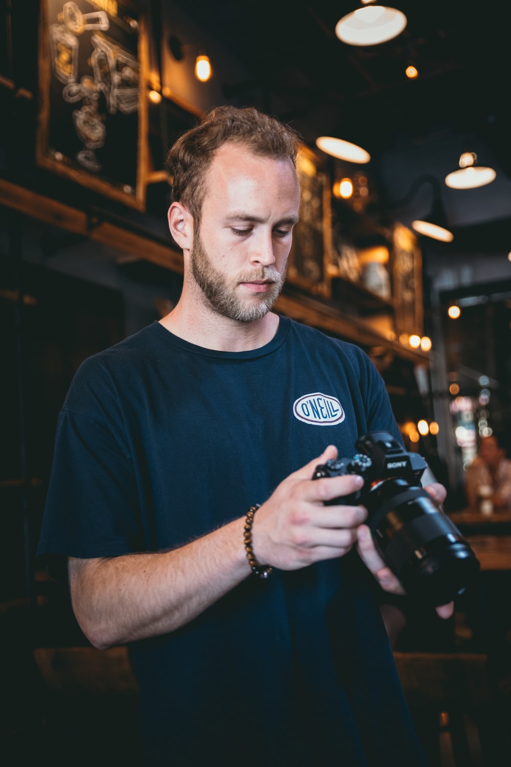 person holds DSLR camera